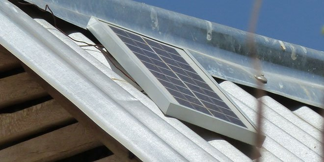 A small solar panel on a roof in Tanzania